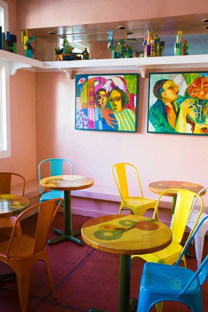 drive-swim-fly-san-juan-bautista-california-jardines-mexican-restaurant-colorful-front-room-sitting-area-tables-chairs-picasso-art