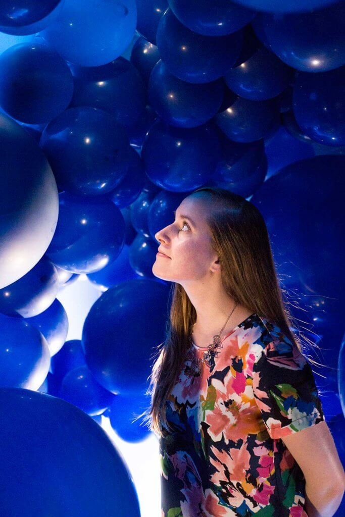 drive-swim-fly-color-factory-san-francisco-union-square-blue-balloon-room-jessica-looking-up