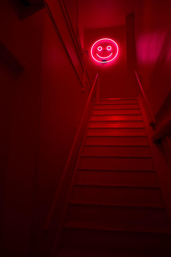 drive-swim-fly-color-factory-san-francisco-union-square-red-room-smiley-face-staircase-stairs