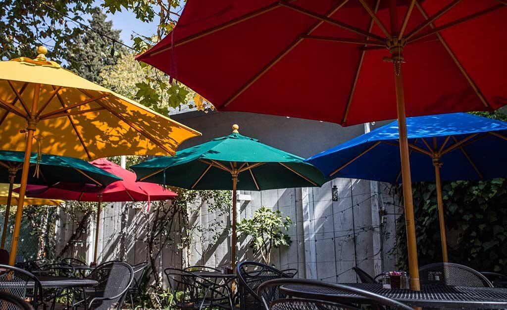 drive-swim-fly-san-juan-bautista-california-jardines-mexican-restaurant-umbrellas-colorful