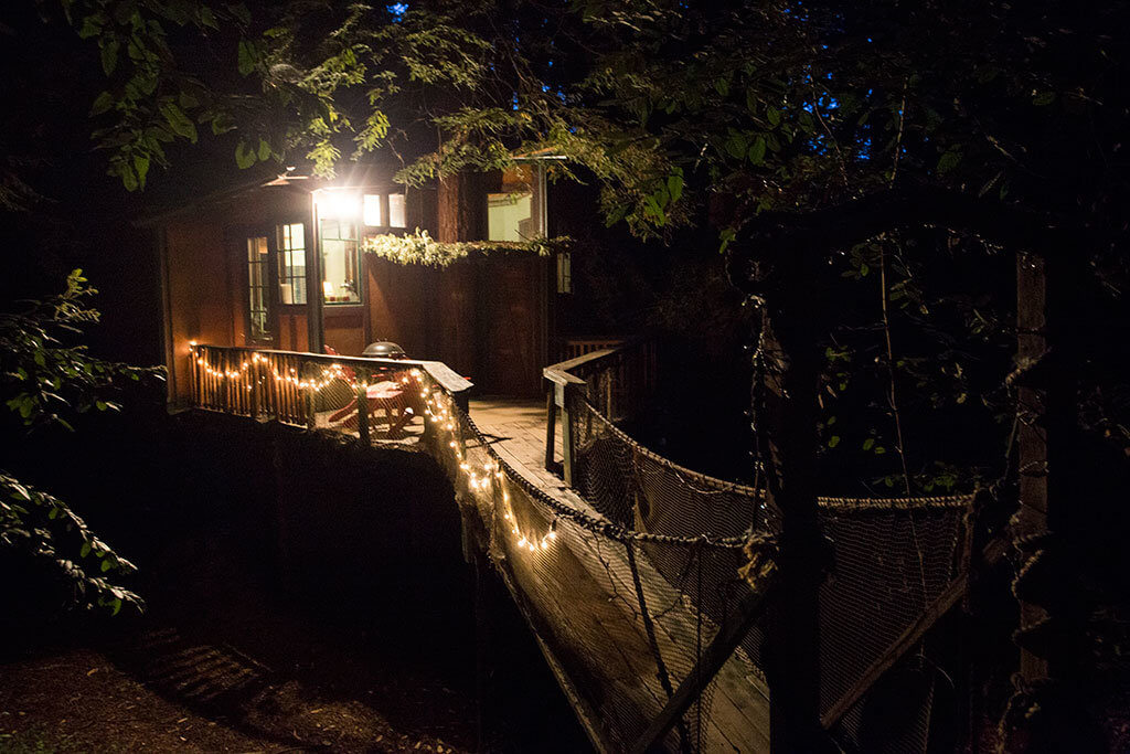 drive-swim-fly-santa-cruz-mountains-treehouse-hotel-night-twinkle-lights