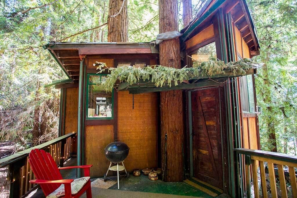 drive-swim-fly-santa-cruz-mountains-treehouse-hotel-outside-red-porch-chair
