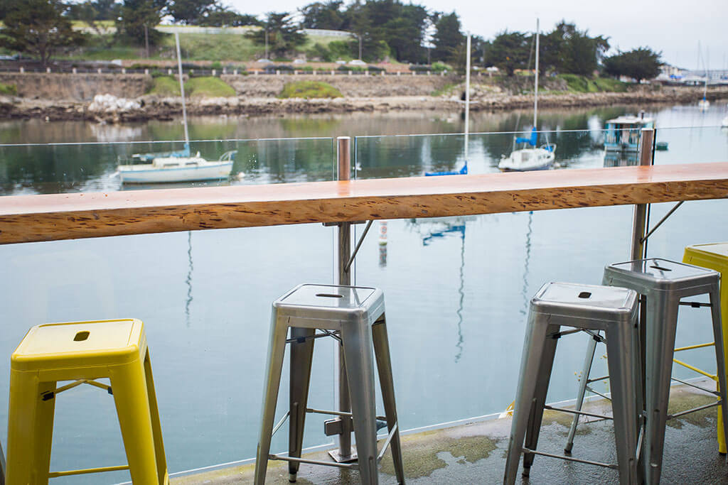drive-swim-fly-monterey-california-water-and-leaves-outdoor-seating-tall-stools
