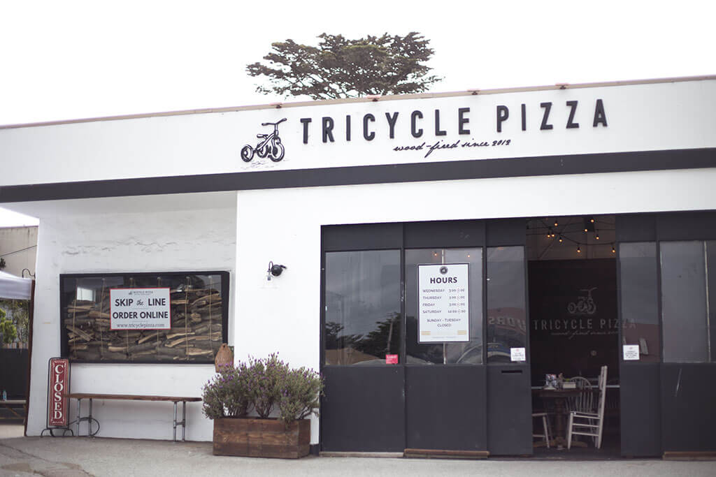 drive-swim-fly-tricycle-pizza-monterey-california-food-truck-bike-front-building-sign-order-online