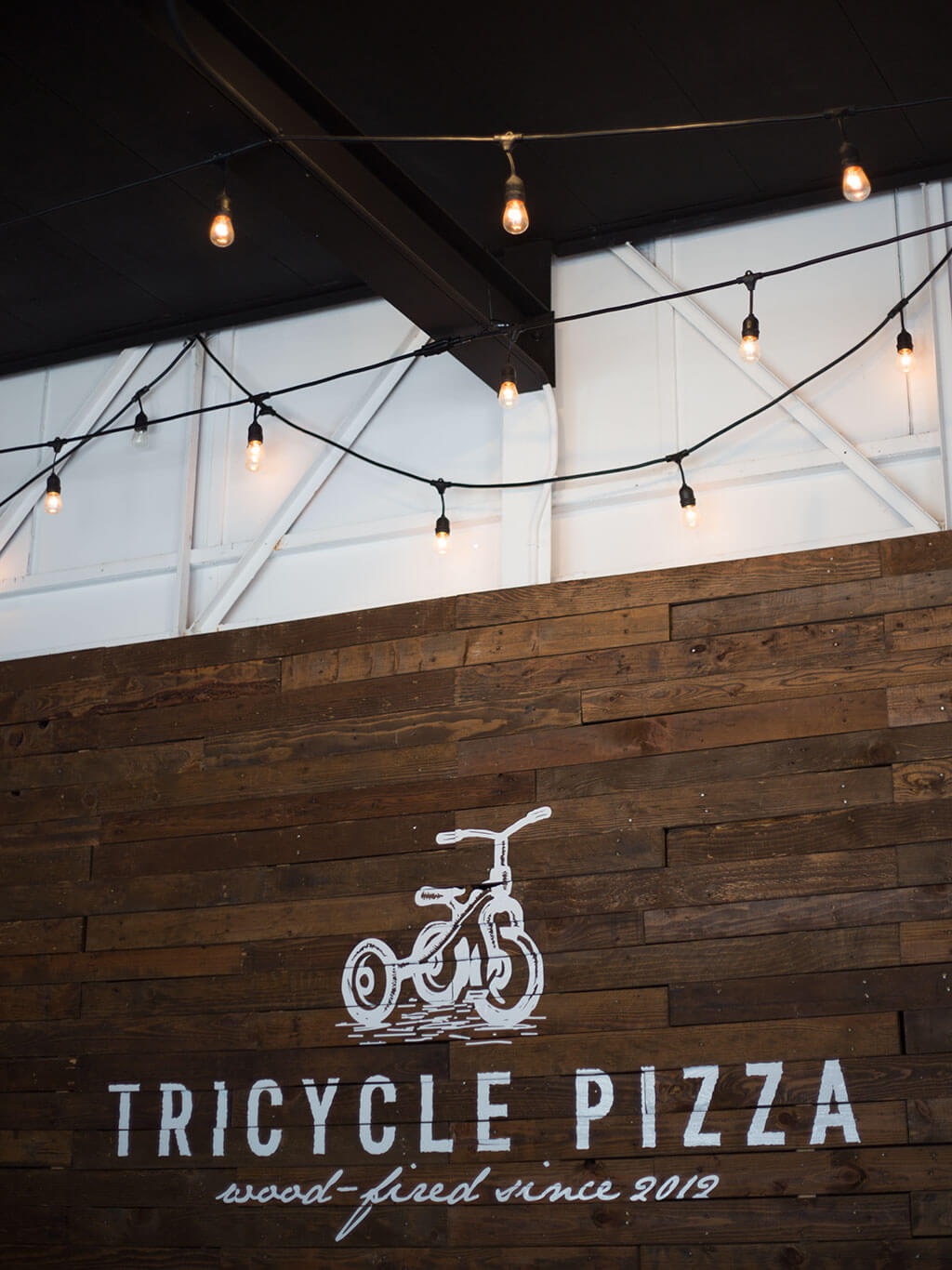 drive-swim-fly-tricycle-pizza-monterey-california-food-truck-bike-indoor-seating-sign