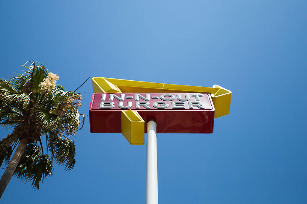 drive-swim-fly-in-n-out-burger-gilroy-california-cheeseburgers-fast-food-west-coast-original-road-sign-close-up