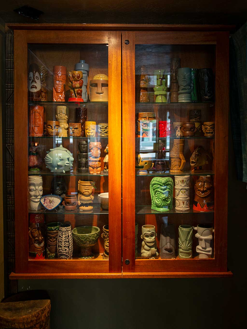 drive-swim-fly-hulas-island-grill-restaurant-monterey-california-tiki-cups-cabinet