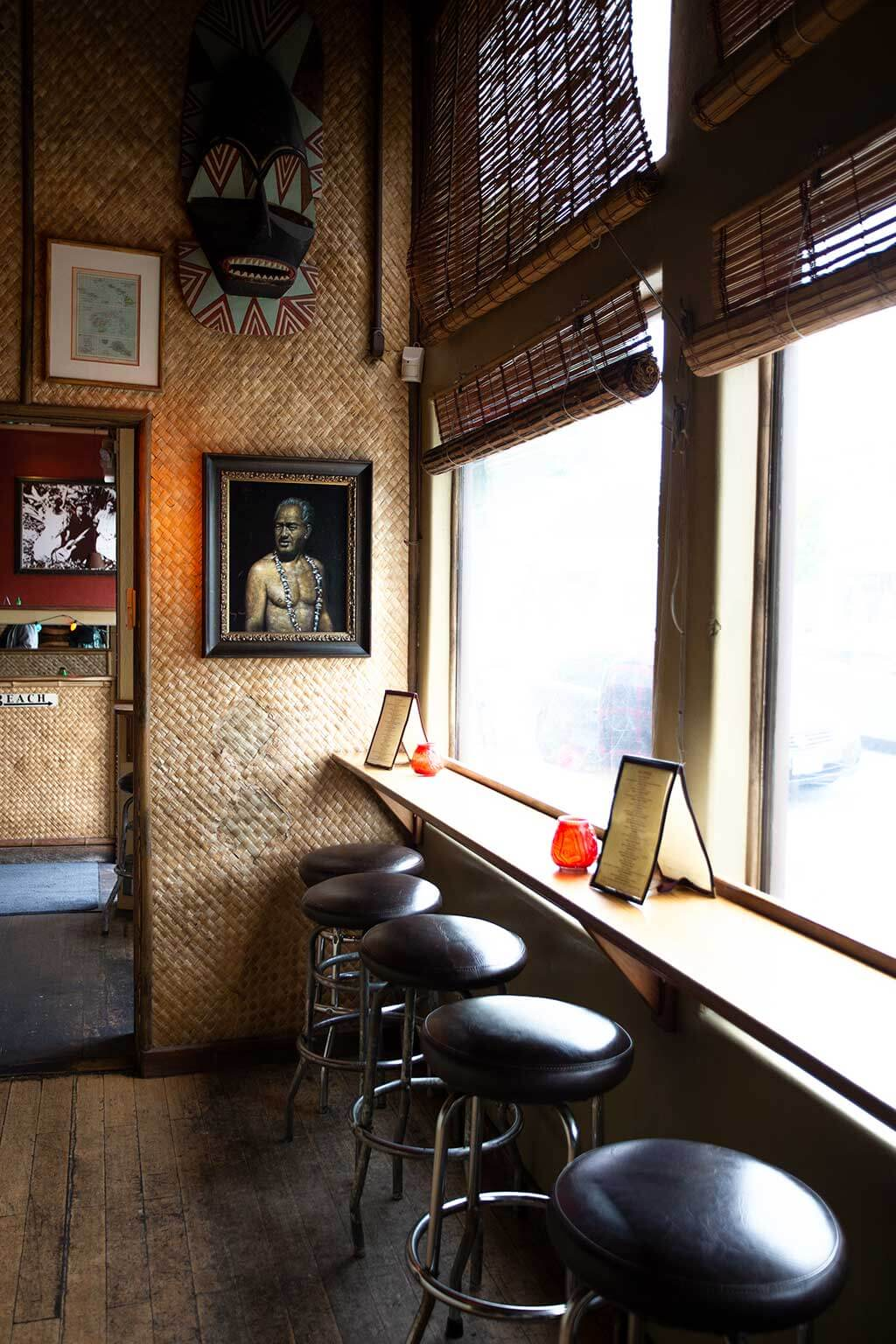 drive-swim-fly-hulas-island-grill-restaurant-monterey-california-wall-seating-bay-window
