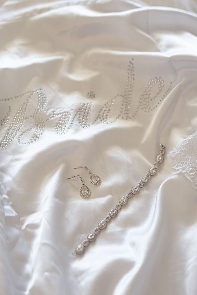 drive-swim-fly-wedding-photography-hollister-california-leal-vinyards-sandy-matthew-wedding-bridal-robe-diamond-jewelry