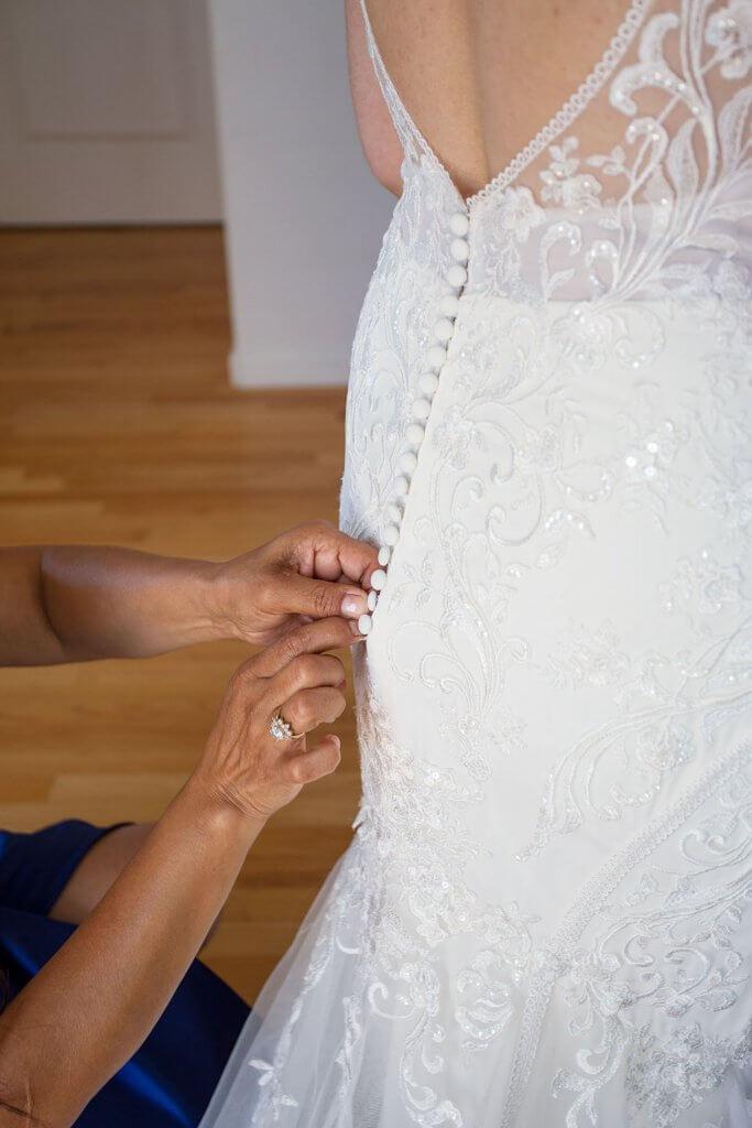 drive-swim-fly-wedding-photography-hollister-california-leal-vinyards-sandy-matthew-wedding-dress-gown-buttons