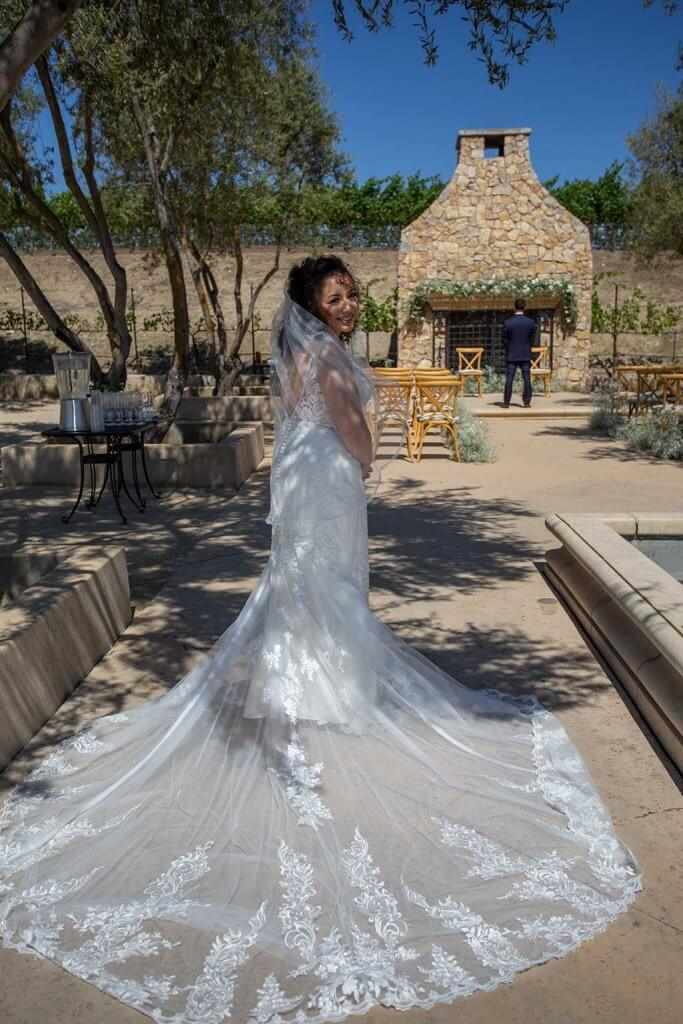 drive-swim-fly-wedding-photography-hollister-california-leal-vinyards-sandy-matthew-wedding-first-look-bride