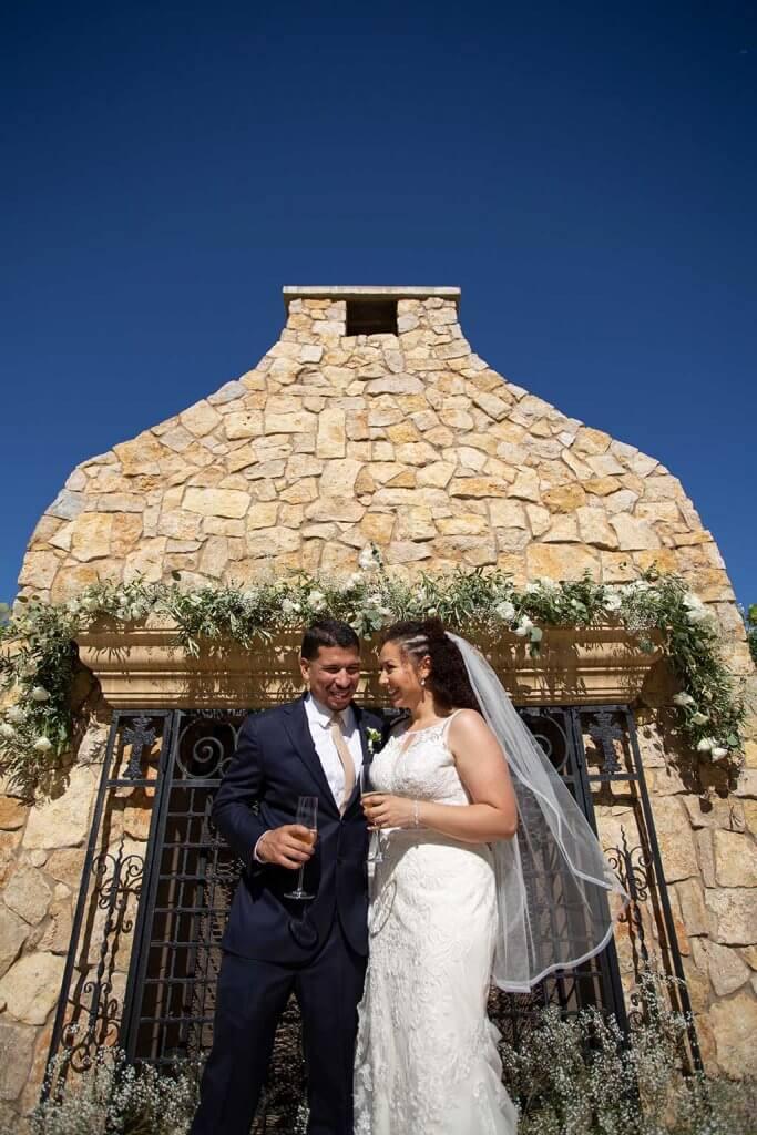 drive-swim-fly-wedding-photography-hollister-california-leal-vinyards-sandy-matthew-wedding-outdoor-fireplace-happy-couple-bride-groom