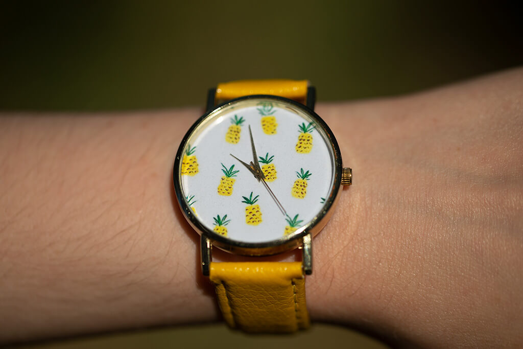 drive-swim-fly-pineapple-collection-pineapple-wrist-watch-yellow-watch-close-up